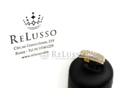 Anello con 0,70ct di diamanti taglio baguette e brillante in oro giallo e bianco foto1