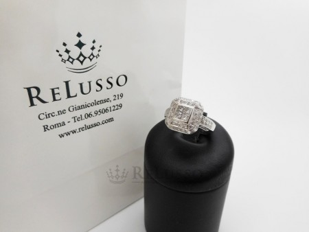 Anello in oro bianco con pavé di diamanti taglio brillante e princess foto1